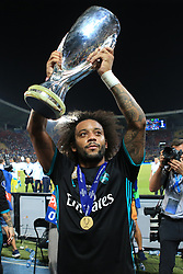 Real Madrid's Marcelo celebrates with the UEFA Super Cup Trophy during the UEFA Super Cup match at the Philip II Arena, Skopje, Macedonia.