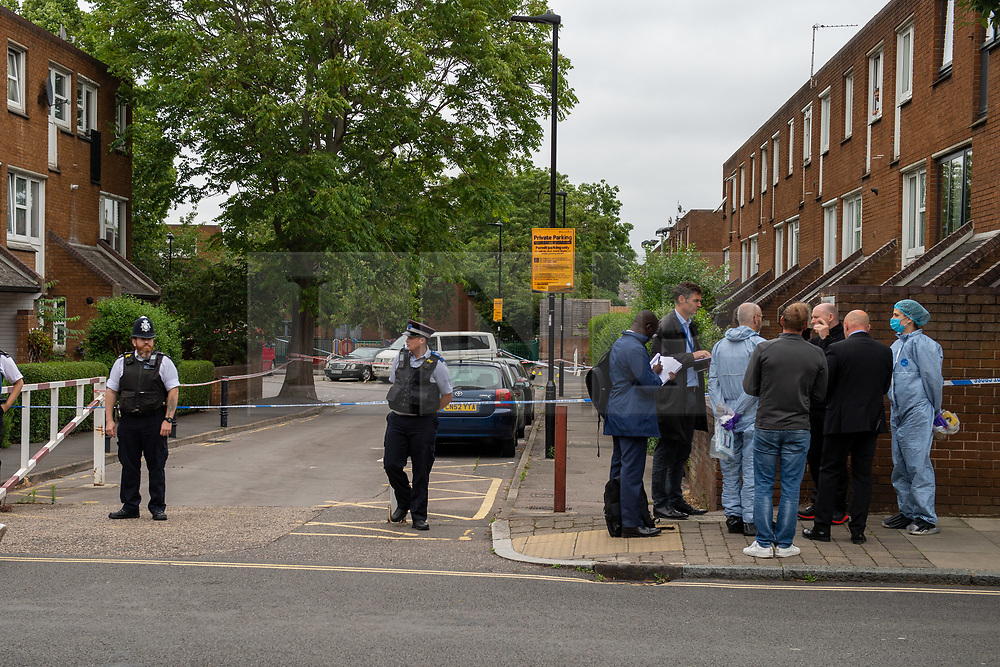 © Licensed to London News Pictures. 04/07/2020. London, UK. Forensic investigators look over the crime scene on Roman Way in Islington. Metropolitan Police Service officers were called at 15:20BST on Saturday, 4 July to Roman Way N7 following reports of shots fired. Officers attended with London Ambulance Service (LAS) and found a man, believed to be aged in his early 20s, suffering from gunshot injuries. Despite their best efforts, he was pronounced dead at the scene. Photo credit: Peter Manning/LNP