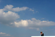 A Spectator watches a sprint race during Epsom Derby day in southern England.