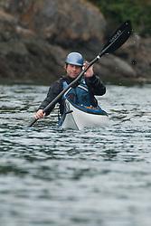 Mathew Paddles off San Juan County Park into the Haro Strait, San Juan Island, Washington, US
