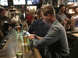 AU_1272913 - New York,   -        *PREMIUM-EXCLUSIVE*  - Former Australian cricket captain, Steve Smith looked sad and lonely in New York.   The disgraced cricketer sat in a bar alone before walking around the streets the following day.<br />