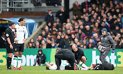 Liverpool's Adam Lallana reacts on the floor injured during the Premier League match at Selhurst Park, London.