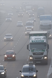 © Licensed to London News Pictures. 16/10/2020. Cobham, UK. Fog hits the M25 near Cobham in Surrey. Low temperatures and fog have hit parts of the United Kingdom this morning. Photo credit: Peter Macdiarmid/LNP