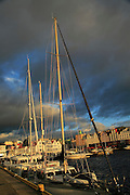 Boats at moorings and historic buildings evening light, Vagen harbour, Bergen, Norway
