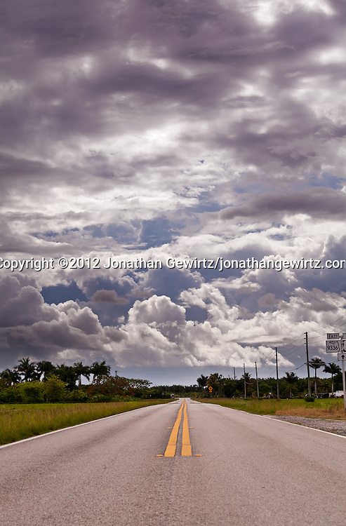 Ingraham Highway, Florida Route 9336, heads away from Everglades National Park and towards Homestead, Florida and a sky filled with dark rain clouds. WATERMARKS WILL NOT APPEAR ON PRINTS OR LICENSED IMAGES.