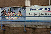 Disintegrated and cracked old fitness pictures outside the old Coventry Swimming Pool which is now closed down on 23rd June 2021 in Coventry, United Kingdom. The photographs show young people enjoying the sport services run by the local authority.