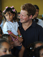 Prince Harry visits the Complexo do Alemão and meets a youth choir, Rio de Janeiro, Brazil, on the 10th March 2012.<br /> PICTURE BY JAMES WHATLING
