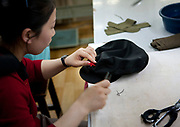 Fashion in North Korea<br /> <br /> In every corner of the earth, women love to look beautiful and keep up with the latest fashion trends. The women of North Korea are no different. Fashion is taken seriously here. But in North Korea, women do not read Elle or Vogue; they just glimpse a few styles by watching TV or by observing the few foreigners who come to visit. In the hermit kingdom, clothing also reflects social status. If you have foreign clothes it means you travel and are consequently close to the centralized power. Chinese products have inundated the country, adding some color to the traditional outfits that were made of vynalon fiber. But citizens beware, too much style means you're forgetting the North Korean juche, the ethos of self-reliance that the country is founded on! But the youth tend to neglect it despite the potential consequences.<br /> <br /> Photo shows: A tailor makes a cap with the iconic communist red star. She told me that sometimes there are not enough red stars, so they cannot produce the foreseen amount each year. This cap is worn by both men and women from the Worker's party.<br /> ©Eric Lafforgue/Exclusivepix Media