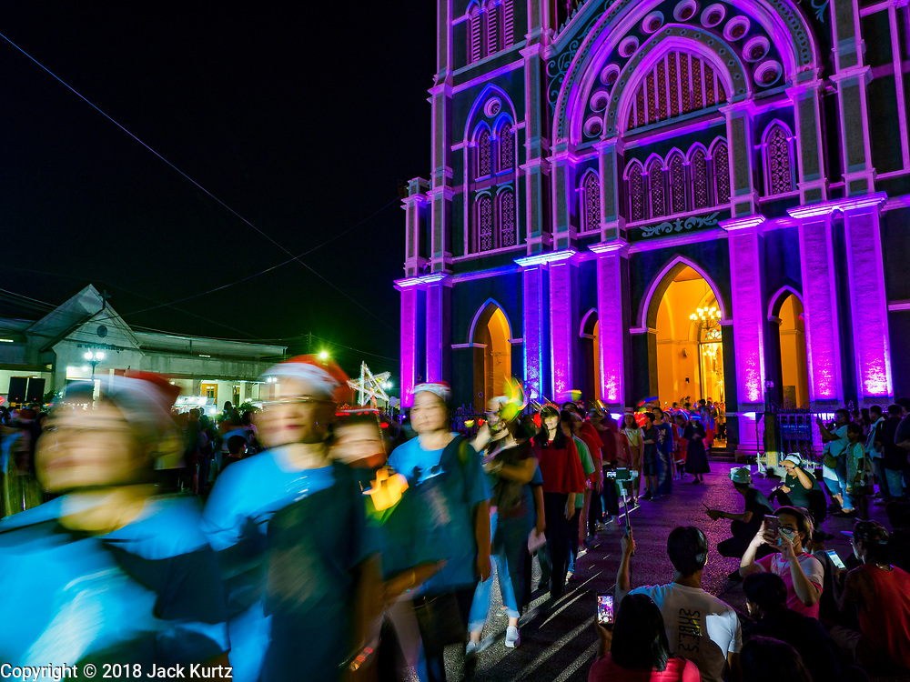"""23 DECEMBER 2018 - CHANTABURI, THAILAND: The Christmas procession at the Cathedral of the Immaculate Conception's Christmas Fair in Chantaburi. Cathedral of the Immaculate Conception is holding its annual Christmas festival, this year called """"Sweet Christmas @ Chantaburi 2018"""". The Cathedral is the largest Catholic church in Thailand and was founded more than 300 years ago by Vietnamese Catholics who settled in Thailand, then Siam.   PHOTO BY JACK KURTZ"""