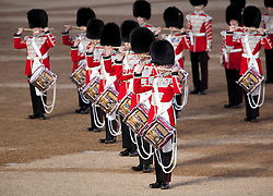 © Licensed to London News Pictures. LONDON, UK  09/06/11. Drummers stand in formation as they perform at the annual Beating of the Retreat at Horse Guards Parade. On two successive evenings each year in June a pageant of military music, precision drill and colour takes place on Horse Guards Parade in the heart of London when the Massed Bands of the Household Division carry out the Ceremony of Beating Retreat. 300 musicians, drummers and pipers perform this age-old ceremony. The Retreat has origins in the early days of chivalry when beating or sounding retreat pulled a halt to the days fighting. Please see special instructions. Photo credit should read Matt Cetti Roberts/LNP. Please see special instructions for usage rates. Photo credit should read Matt Cetti-Roberts/LNP