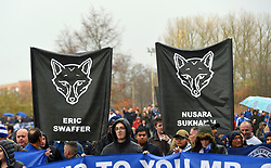 Fans on a memorial walk for those who lost their lives in the Leicester City helicopter crach including Leicester City Chairman Vichai Srivaddhanaprabha ahead of the Premier League match at the King Power Stadium, Leicester.