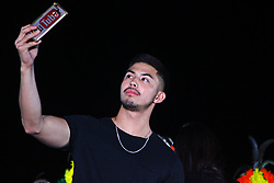 November 10, 2018 - Philippines - Actor Tony Labrusca making selfie during his guesting at the 8th Tanay Hane Festival on November 10, 2018. The annual Hane Festival is the commemoration of the Municipality of Tanay's Founding Anniversary. It is an agri – eco – tourism, arts, and cultural exhibition in one, showcasing Tanay's vibrant tourism, abundant agricultural produce, healthy and sustainable environment, rich arts and culture, and amiable people. It derived its name from an ordinary expression of Tanayan (''hane'') which is used to seek one's agreement. This year the Hane festival will be celebrated from Novemver 10 – 13, 2018 with various activities. (Credit Image: © Gregorio B. Dantes Jr/Pacific Press via ZUMA Wire)