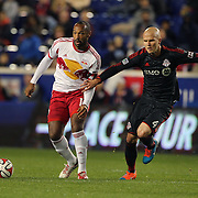 Thierry Henry, (left), New York Red Bulls, challenged by Michael Bradley, Toronto FC, during the New York Red Bulls Vs Toronto FC, Major League Soccer regular season match at Red Bull Arena, Harrison, New Jersey. USA. 11th October 2014. Photo Tim Clayton