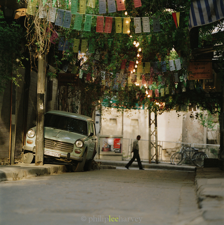 A man crosses the street early in the morning in Damascus, Syria