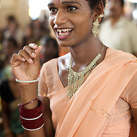 In the audience of an Aravani beauty pageant in Vilappuram...India's transexual community has a recorded history of more than four thousand years. Many consider the The Third Sex, also known as Aravanis, to posses special powers allowing them to determine the fate of others. As such, they are not only revered but despised and feared too. Resigned to the fringes of society, segregated and excluded from most occupations, many Aravanis are forced to turn to begging and sex work in order to earn a living. ..The annual transgender festival in the village of Koovagam, near Vilappuram, offers an escape from this often desolate existence. For some, the week-long partying and frenetic sex trade that culminates in the Koovagam festival is about fulfilling lustful desires. For others, the gathering provides a chance for transgenders to bond, share experiences, join the wider homosexual gay-community and coordinate their campaign for recognition and tackle the challenge of HIV/AIDS. ..It is the Indian state of Tamil Nadu that the eighty-thousand-strong Aravani community has made advances in their fight for rights. In 2009, the Tamil Nadu state government began providing sex-change surgery free of cost. The state has also offers special third-gender ration cards, passports and reserved seats in colleges. And 2008 the launch of Ippudikku Rose, a Tamil talk-show fronted by India's first transgender TV-host and the release of a mainstream Tamil film staring an Aravani in the lead-role. ..These advances clearly signal a victory for south India's transgenders, but they have also exposed deep divisions within the community. There is a very real gulf that separates the majority poor from their potentially influential but often reticent, upper-class sisters. ..Photo: Tom Pietrasik.Vilappuram District, Tamil Nadu. India.May 2009