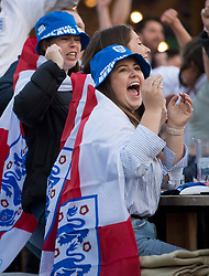 © Licensed to London News Pictures. 22/06/2021. London, UK. England fans celebrate going 1-0 up during the Euro 2020 group game between Czech Republic and England at Skylight Rooftop in Tobacco Dock, east London. Photo credit: Ben Cawthra/LNP