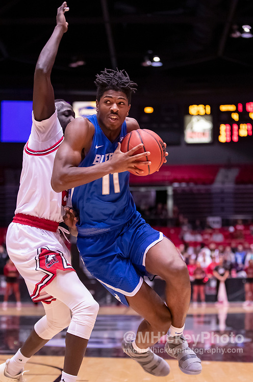 DEKALB, IL - JANUARY 22: Jeenathan Williams #11 of the Buffalo Bulls drives to the basket against Gairges Daow #2 of the Northern Illinois Huskies at NIU Convocation Center on January 22, 2019 in DeKalb, Illinois. (Photo by Michael Hickey/Getty Images) *** Local Caption *** Jeenathan Williams; Gairges Daow
