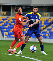 Football - 2020 /2021 Sky Bet League One - AFC Wimbledon vs Portsmouth - Plough Lane<br /> <br /> Ollie Palmer of Wimbledon  and Marcus Harness of Portsmouth<br /> <br /> Credit : COLORSPORT/ANDREW COWIE