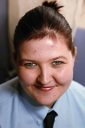 Portrait of a young woman with learning disabilities in a uniform,