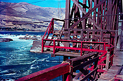 CS00962-04. Deck of the ruins of the old Tumwater fishwheel No. 2 in the 1940s. On the left is Big island, on the right is Papoose island and behind it Chief island.
