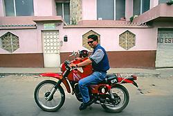 Man & Boy On Motorcycle