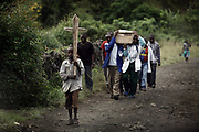 Congolese men carry a coffin of a 15-year-old boy who died in an IDP (Internally Displaced Persons) camp in North Kivu. After a decade-long armed conflict, more than 5,4 million people are displaced in IDP camps and villages in Democratic Republic of the Congo.