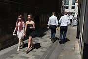 As heatwave temperatures climb to record levels - the hottest day of the year so far - Londoners in the City of London the capitals financial district aka the Square Mile walk in lunchtime sunshine, on 25th July 2019, in London, England.