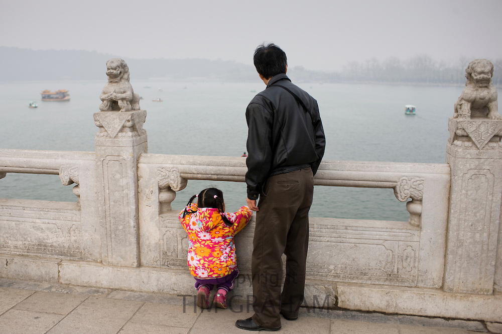 Father and child at Summer Palace, Beijing. China has a one child family planning policy to limit population.