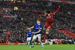 10th December 2017 - Premier League - Liverpool v Everton - Mohamed Salah of Liverpool gets a header in - Photo: Simon Stacpoole / Offside.