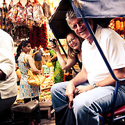 Tourists explore the bylanes of Old Delhi area by cycle rickshaw, which will cost approx Rs.150 for an hour.