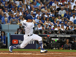 October 24, 2017 - Los Angeles, California, U.S. - Los Angeles Dodgers' Austin Barnes singles against the Houston Astros in the third inning of game one of a World Series baseball game at Dodger Stadium on Tuesday, Oct. 24, 2017 in Los Angeles. (Photo by Keith Birmingham, Pasadena Star-News/SCNG) (Credit Image: © San Gabriel Valley Tribune via ZUMA Wire)