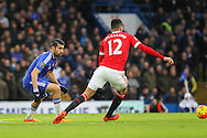 Chelsea's Diego Costa takes on Chris Smalling of Manchester United during the Barclays Premier League match between Chelsea and Manchester United at Stamford Bridge, London, England on 7 February 2016. Photo by Phil Duncan.