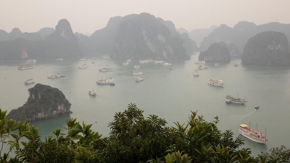 """Halong Bay, Gulf of Tonkin is a UNESCO World Heritage Site and popular travel destination in Quảng Ninh Province, Vietnam. The bay features thousands of limestone karsts and isles in various shapes and sizes. The name Hạ Long means """"descending dragon"""""""