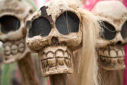 Closeup of laughing skulls on walking sticks at the WOMAD (World of Music; Arts and Dance) Festival in reading; 2005,