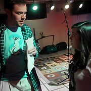 Devin DiMattia, left talks to Holly Cole during Pineapple Shaped Lamps' premiere party for Sketch 22, a show that airs on the Cape Fear CW. (Jason A. Frizzelle)