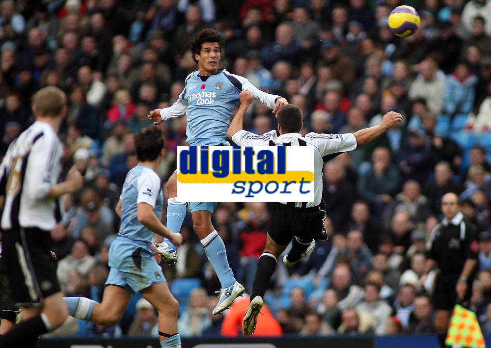 Photo: Paul Thomas.<br /> Manchester City v Newcastle United. The Barclays Premiership. 11/11/2006.<br /> <br /> Bernado Corradi (C) of Man City climbs high to win the ball from Newcastle Steven Taylor (27).