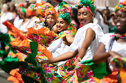 Dancers line the streets during a walkabout by the Prince of Wales and the Duchess of Cornwall in St George's during a one day visit to the Caribbean island of Grenada.