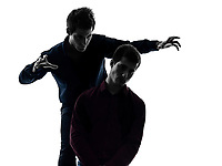 two  young men domination concept shadow white background