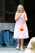 Photo shootof the Royal Family on their home De Horsten estate in Wassenaar.<br /> <br /> Op de foto:<br /> <br /> <br /> <br /> <br /> <br />  DUTCH  Prinses Amalia blaast maandag op een oranje vuvuzela in de tuin van Landgoed de Horsten ENGLISH Princess Amalia blows on Monday vuvuzela an orange in the garden of the De Horsten estate in Wassenaar during a photo session