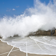 Waves crashing over the parking lot in Rethymno, Crete island, Greece