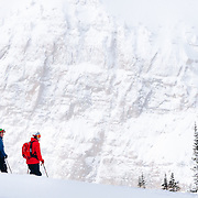 L-R Bryce Newcomb, Eric Seymour, and Andrew Whiteford stand on a ridge to discuss their route of travel in the Teton Backcountry near Jackson Hole Mountain Resort in Teton Village, Wyoming.