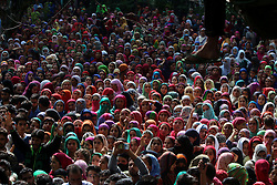August 3, 2017 - Kulgam, Jammu and Kashmir, India - Kashmiri women watching funeral procession of during the funeral of a slain Kashmiri Young Rebel Aaquib Hamid Itoo  at Gopalpora village of Kulgam District, 80 Km from Srinagar. Itoo was killed along with another associate Suhail Ah in a gunfight with forces in Kulgam. (Credit Image: © Muneeb Ul Islam/Pacific Press via ZUMA Wire)
