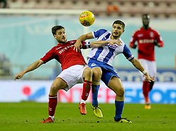 Charlton Athletic's Johnnie Jackson and Wigan's Sam Morsy battle for the ball
