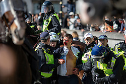 © Licensed to London News Pictures. 13/06/2020. London, UK. A man with a bloodied face is led away by police after clashing with Black Lives Matter protesters in Trafalgar Square. Protests have taken place across the United States and in cities around the world in response to the killing of George Floyd by police officers in Minneapolis on 25 May. Photo credit: Rob Pinney/LNP