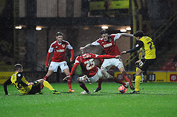 Bristol City's Aden Flint  and Bristol City's Marvin Elliott attempt to keep the ball in the goalmouth scramble - Photo mandatory by-line: Dougie Allward/JMP - Tel: Mobile: 07966 386802 14/01/2014 - SPORT - FOOTBALL - Vicarage Road - Watford - Watford v Bristol City - FA Cup - Third Round - replay