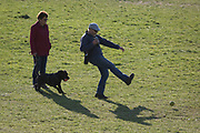 In the third week of the UK government's lockdown during the Coronavirus pandemic, when the daily UK death rate rose by another 761 to 12,868 and with nearly 100,000 reported cases. Londoners take their daily exercises with their dog in Ruskin Park, a public green space in the south London borough of Lambeth, on 15th April 2020, on 15th April 2020, in London, England.