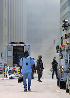 13 September 2001: Male first responder returns from ground zero empty handed after being unable to help find live persons following the Terrorist attack on the America's.  Lower Manhattan, NY. Area surrounding ground zero where the World Trade Centers WTC once stood only hours after they fell to the ground in New York.  Islamic terrorist Osama bin Laden declares The Jihad or Holy War against The United States of America on September 11, 2001. Headline news photos available for editorial use.