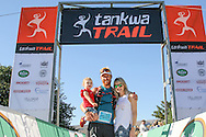 AJ Calitz poses with his daughter, Emilie, and wife, Paulette, after winning the 2017 Tankwa Trail, on the 19th of February. Photo by Oakpics / Dryland Event Management / Sportzpics {dem16gst}