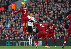 Liverpool's Fabinho (left) wins a header against Fulham's Aleksandar Mitrovic during the Premier League match at Anfield, Liverpool.