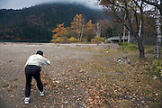 tourist photographing autumn scenic color view Japan